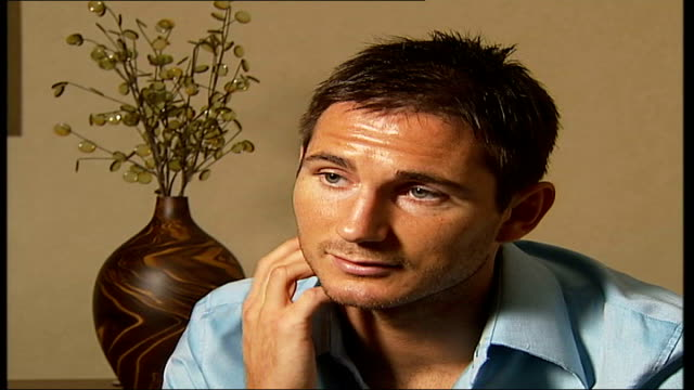 frank lampard interview about autobiography; england: london: int frank lampard interview sot - i was happy, first game played last night i managed... - autobiography stock videos & royalty-free footage