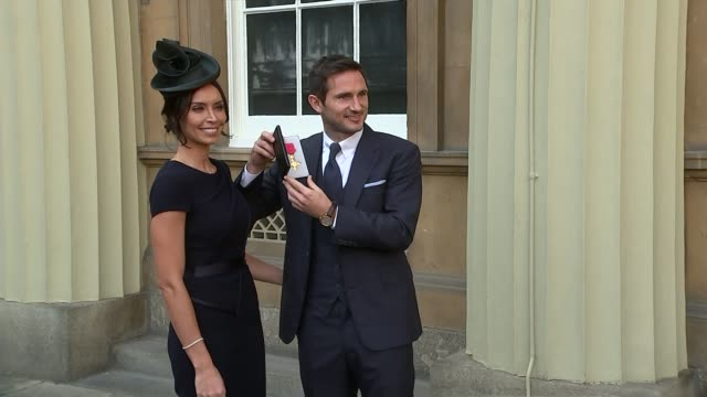 frank lampard recieves obe; london: buckingham palace: ext frank lampard obe interview sot lampard holding obe medal case and posing for photo with... - christine bleakley stock videos & royalty-free footage