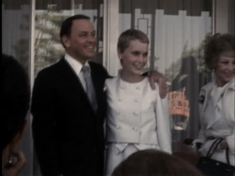 frank sinatra and mia farrow pose for photographers on their wedding day, july 19, 1966. - music or celebrities or fashion or film industry or film premiere or youth culture or novelty item or vacations stock videos & royalty-free footage