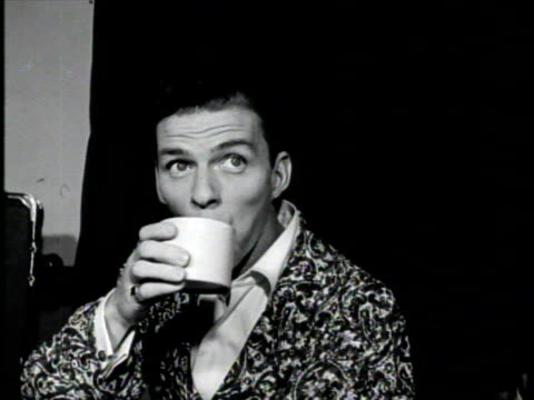 frank sinatra in his dressing room drinking coffee and eating a sandwich in a robe. - frank sinatra stock videos & royalty-free footage
