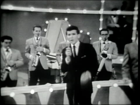 "vídeos de stock e filmes b-roll de frank sinatra jr. and the tommy dorsey orchestra perform ""from this moment on"" . cornetist charlie davis & saxophone player sam donohue solo. - television show"