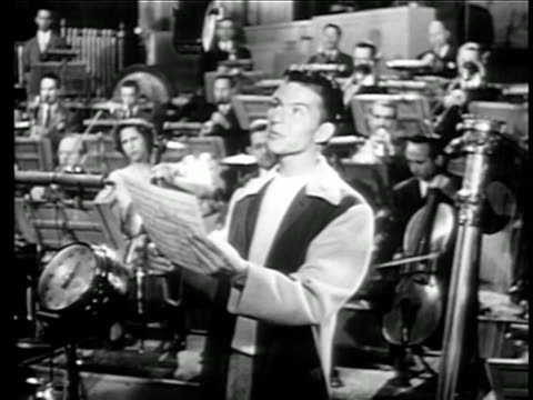 frank sinatra singing in studio with large orchestra / short film - frank sinatra stock videos & royalty-free footage