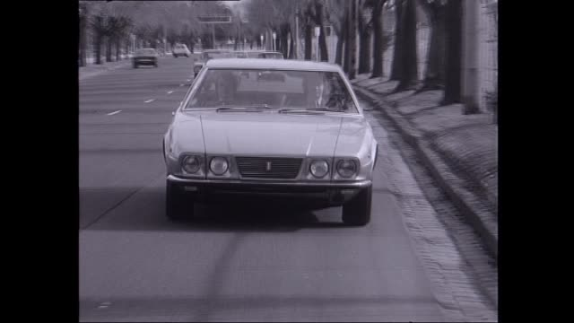 frank sinatra's 'detomaso deauville' car drives on melbourne road and pulls over / david johnston reporter hops out of the car and talks about... - classic car stock videos and b-roll footage