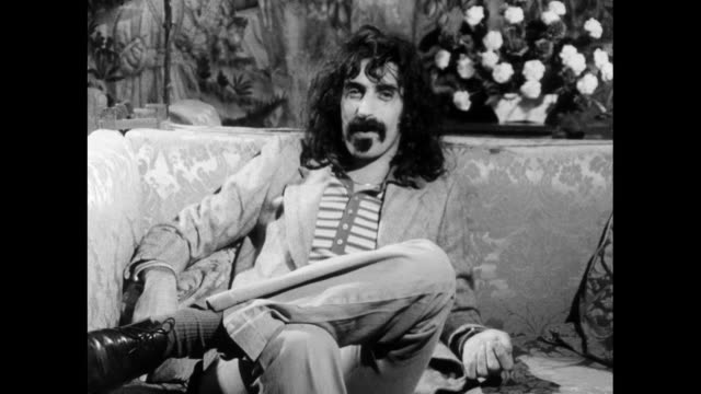 frank zappa speaking in 1971 on the sincerity of popular music and whether it's truly honest in its influences and message i believe in evolution... - cross legged stock videos & royalty-free footage