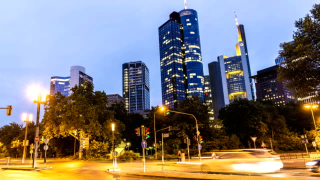 Frankfurt business district with traffic in the night, time lapse