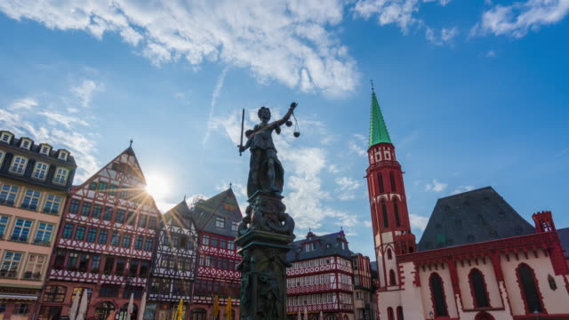 frankfurt old town square romerberg with justitiabrunnen statue in frankfurt at sunrise- 4k time lapse (tilt-up) - old town stock videos & royalty-free footage
