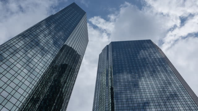 frankfurt skyscraper mirroring clouds - financial building stock videos and b-roll footage