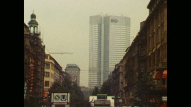 frankfurt/main main station view to main entrance traffic with tram view to banking tower - main tower stock-videos und b-roll-filmmaterial