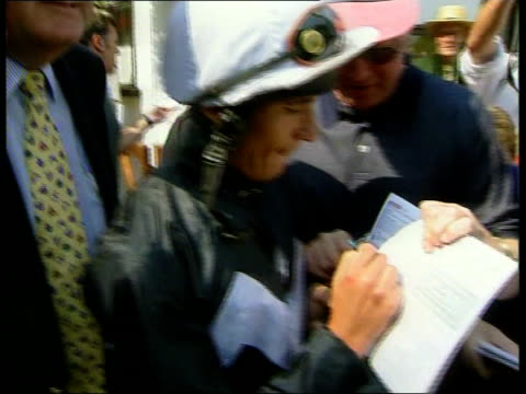 frankie dettori back after plane crash; england: cambridgeshire: newmarket: ext jockey frankie dettori along signing autographs jockey frankie... - ecstatic stock videos & royalty-free footage