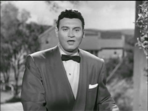 "b/w 1954 frankie laine sings ""do not forsake me"" to camera in ""countryside"" setting / tv program - 1954 stock videos and b-roll footage"