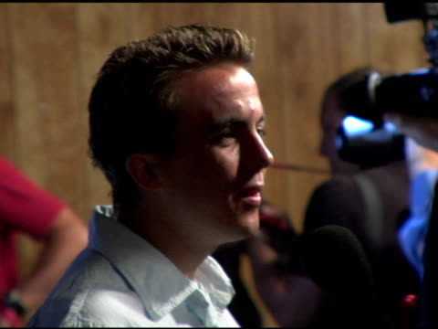 Frankie Muniz at the 'TMobile Sidekick II' Launch Party arrivals at the Grove in Los Angeles California on August 5 2004