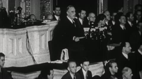 vidéos et rushes de franklin d. roosevelt asking congress to declare war on japan after bombing of pearl harbor / washington d.c., usa - 1941