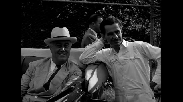 franklin d roosevelt is driven into field in open car / fdr visiting speaks with lowell thomas others franklin d roosevelt at outdoor party on... - eastern usa stock videos and b-roll footage