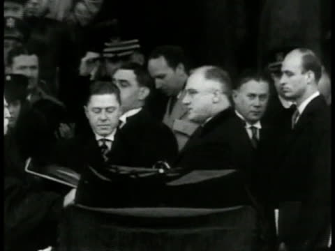 franklin delano roosevelt taking oath of office standing before chief justice charles evans hughes sot fdr 'office of president of the united states... - 1937 stock videos and b-roll footage