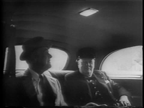 vídeos de stock e filmes b-roll de franklin roosevelt and winston churchill meet to plan battle of europe as battle of africa / pattern for invasion / black cars drive up to the white... - banco do passageiro