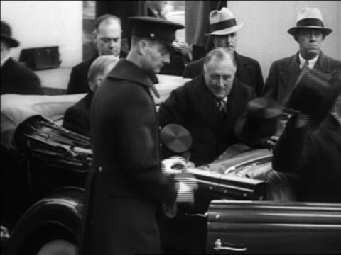 stockvideo's en b-roll-footage met franklin roosevelt + herbert hoover sitting in back of convertible / inauguration day - 1933