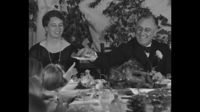 franklin roosevelt presides over thanksgiving dinner at georgia hall of the roosevelt warm springs institute with eleanor at end of table roosevelt... - thanksgiving plate stock videos & royalty-free footage