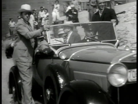 vídeos de stock, filmes e b-roll de franklin roosevelt riding in convertible car, crowds. fdr waving from train, native american indians fg. vacation, new deal. - 1933