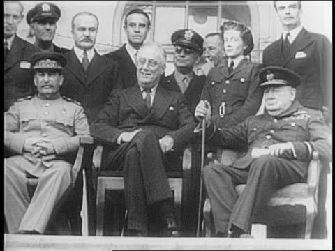 franklin roosevelt, winston churchill, joseph stalin seated with vyackeslav molotov, british foreign secretary anthony eden, others behind/stalin,... - 1943 stock-videos und b-roll-filmmaterial