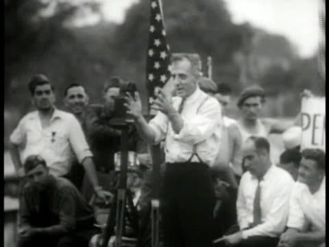 franklin roosevelt writing at desk. vs speaker at rally, huey 'kingfish' long talking, upton sinclair at desk, dr. townsend talking, father charles... - 1933 stock-videos und b-roll-filmmaterial