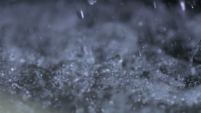 frantic water surface as large drops rain onto it - falling water stock videos & royalty-free footage