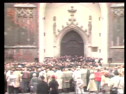 b germany bavaria munich munich cathedral ext la twin clock towers tilt down crowds queue in bv tbv crowds queueing int tbv congregation as altar in... - religiöse kleidung stock-videos und b-roll-filmmaterial