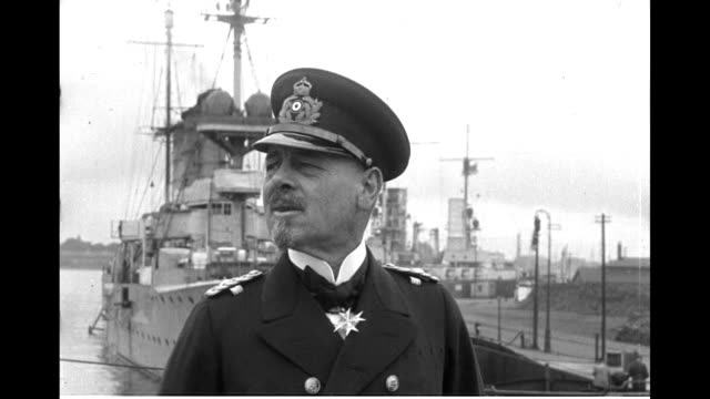Franz Ritter von Hipper poses with high ranking naval officers / Close up of von Hipper with warships at rear / Admiral Reinhard Scheer boards ship...