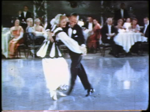 fred astaire ginger rogers dancing on dance floor of club as seated crowd looks on / feature - 俳優点の映像素材/bロール
