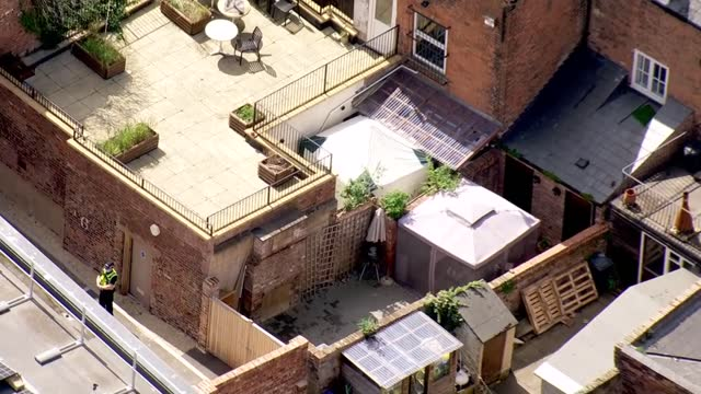 aerials of crime scene in gloucester; england: gloucester: ext air views / aerials forensics tent outside 'the clean plate' cafe on southgate street... - crime and murder stock videos & royalty-free footage