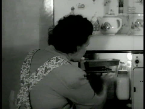 'walker' home kitchen int ms 'freda walker' opening electric refrigerator removing jar vs freda preparing food cu southern fried chicken in pan ohio... - homemaker stock videos and b-roll footage