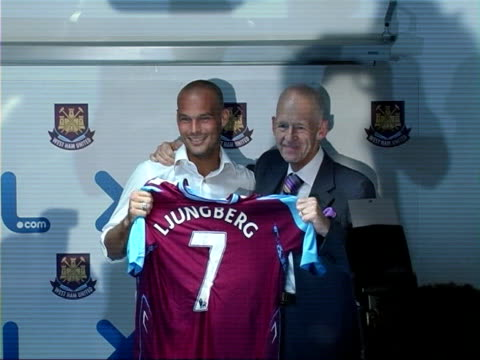 freddie ljungberg signs for west ham; england: london: int **flash photography** freddie ljungberg holding up number 7 shirt as posing for photocall... - number 7 stock videos & royalty-free footage