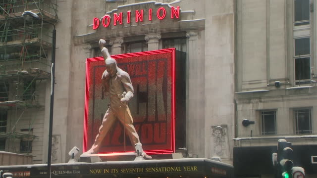 MS Freddy Mercury statue covered with snow above Dominion Theatre entrance, London, United Kingdom