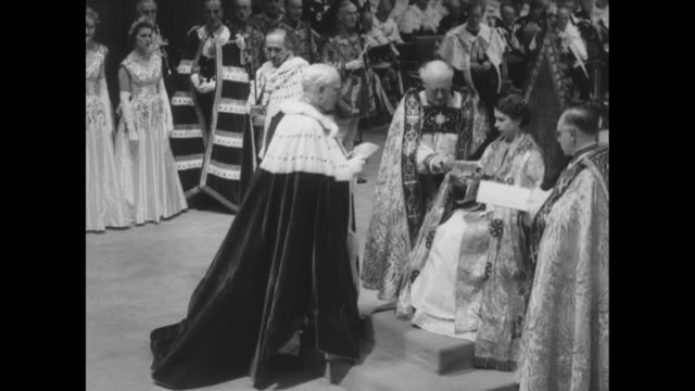 cu frederick marquis viscount woolton presents elizabeth a glove / elizabeth seated on coronation chair adjusting glove / cu profile of prince philip - coronation stock videos and b-roll footage