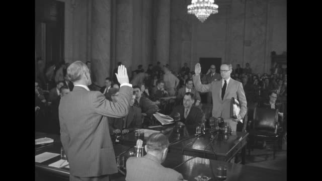 Frederick Vanderbilt Field takes oath prior to testimony before the Senate Subcommittee on the Investigation of Loyalty of State Department Employees...