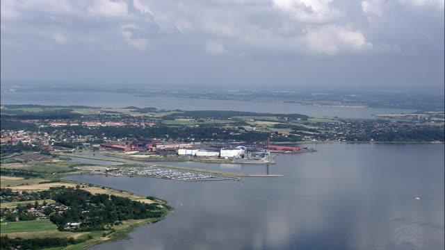 frederiksvaek and roskilde fjord  - aerial view - capital region, halsnæs kommune, denmark - capital region stock videos and b-roll footage