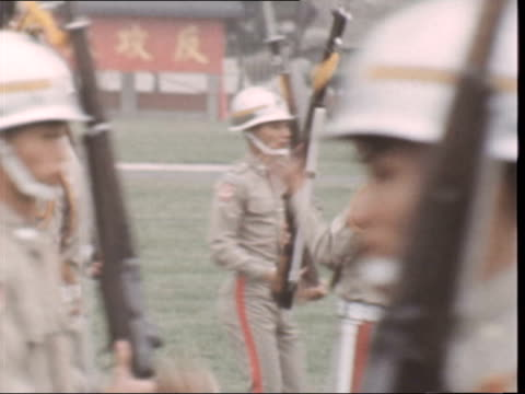 b) nb this material was serviced 15.10.71 they hold orig neg taiwan: ext two soldiers in hand to hand combat cms ditto ditto: zoom in one breaks... - taiwan stock videos & royalty-free footage