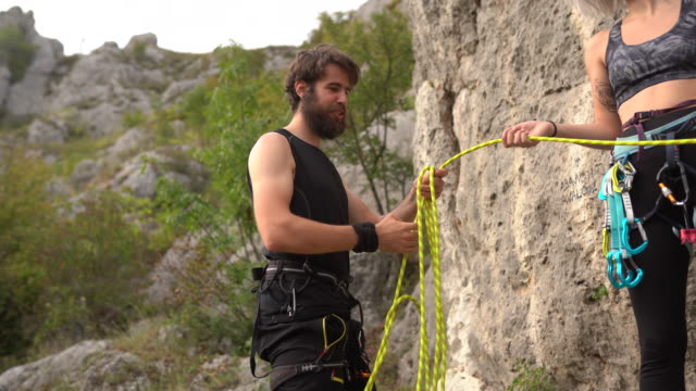 free climbers preparing climbing equipment before climbing rock at nature - climbing equipment stock videos & royalty-free footage