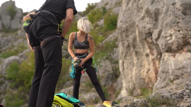 free climbers securing climbing equipment before they start climbing - free climbing stock videos & royalty-free footage