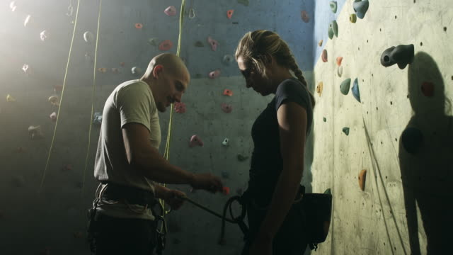 free climbing instructor with young woman - free climbing stock videos and b-roll footage