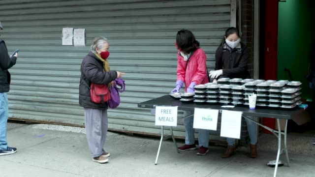 free food meals distribution in chinatown. amid the outbreak of the coronavirus disease , per order of the ny governor non-essential stores remain... - recession stock videos & royalty-free footage