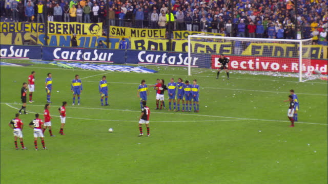 ws free kick during football match at stadium / buenos aires, argentina - argentina stock-videos und b-roll-filmmaterial