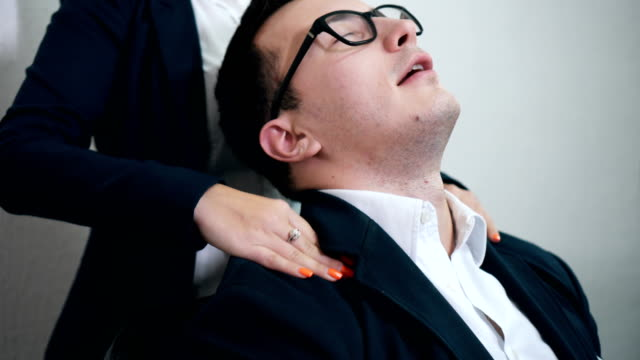 free massage for stressed director - physical pressure stock videos and b-roll footage