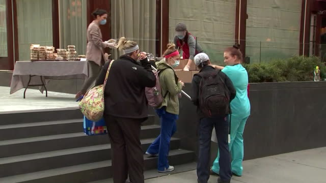 free meals are distributed to hospital nurses during the covid-19 pandemic in new york city. - healthcare and medicine or illness or food and drink or fitness or exercise or wellbeing stock videos & royalty-free footage
