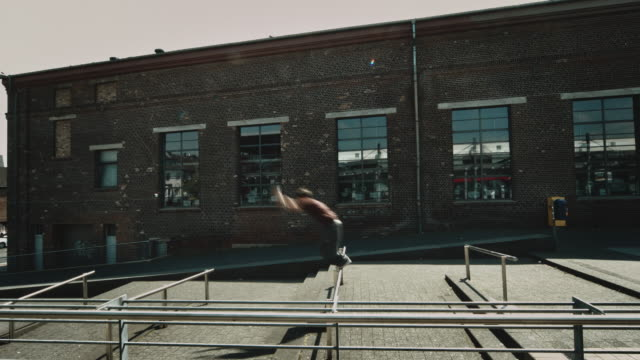 free runner jumping in street - balance stock videos & royalty-free footage