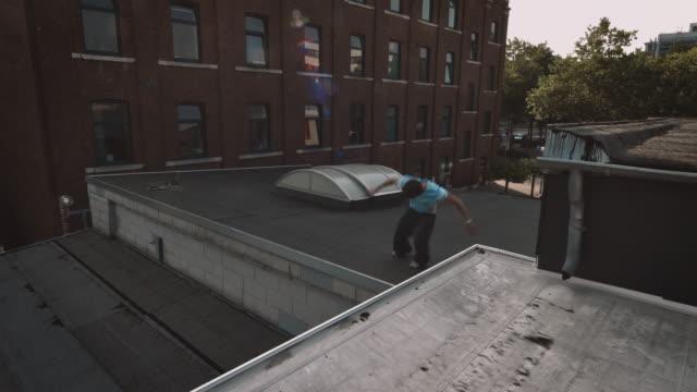 free runner on rooftop - danger stock videos & royalty-free footage