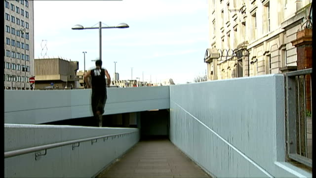 free runners to help train royal marine commandos england london south bank ext free runner leaping from railings on pedestrian underpass and... - underpass stock videos and b-roll footage