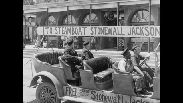 1928 A free shuttle to the Stonewall Jackson steamboat drives through town