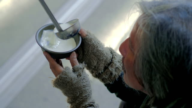 free soup in a bowl of beggar and ladle.volunteering,giving - giving stock videos & royalty-free footage