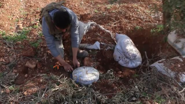 Free Syrian Army fighters remove landmines that were placed by Daesh terrorists in an olive field in AlBab town after liberation of the town from...