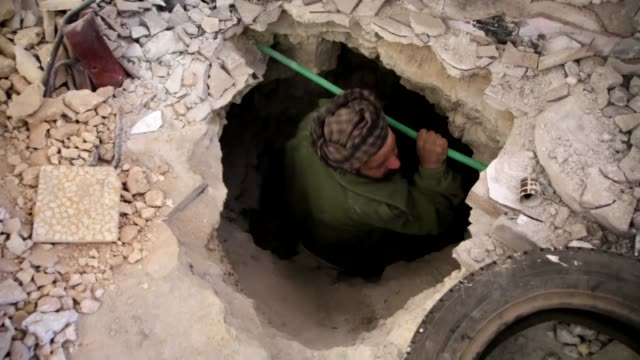 vídeos de stock, filmes e b-roll de free syrian army members have taken control of st vartan armenian catholic church after attacking to syrian regime forces from 20meters length of... - tunnel